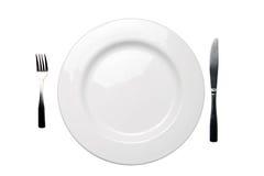 Cuchillo de la fork de la placa de cena y camino de recortes blancos imágenes de archivo libres de regalías