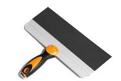 Cuchillo de masilla con la manija de goma negra y anaranjada Fotografía de archivo