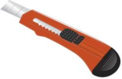 Cuchillo de papel del cortador sostenido rojo Fotografía de archivo