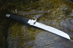 Cuchillo de Tanto en agua Imágenes de archivo libres de regalías