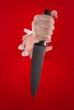 Cuchillo en la mano Imagen de archivo