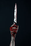 Cuchillo sangriento del demonio del zombi de las manos Foto de archivo libre de regalías