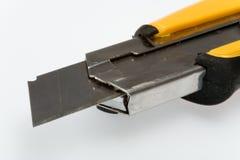 Cuchillo utilitario retractable sostenido Foto de archivo libre de regalías