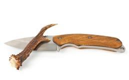 Cuchillo y cornamenta fotografía de archivo libre de regalías