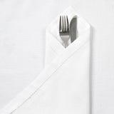 Cuchillo y fork con la servilleta de lino Imagenes de archivo
