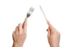 Cuchillo y fork en manos Fotografía de archivo