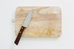 Cuchillo y tabla de cortar usados en cocina japonesa, en la vida real Imagen de archivo libre de regalías