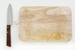 Cuchillo y tabla de cortar usados en cocina japonesa, en la vida real Imagen de archivo