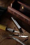 Cuchillos y caja de herramientas utilitarios Imágenes de archivo libres de regalías