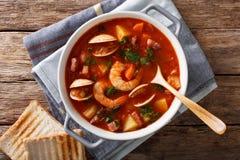 Cucina americana: Primo piano della minestra della zuppa di molluschi e latte di Manhattan horizonta Immagini Stock