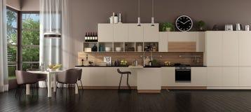 Cucina beige moderna in una villa immagini stock
