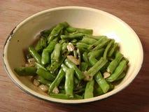 Cucina dei fagiolini verdi Immagini Stock