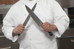 Cucina dell'annuncio pubblicitario di Sharpening Knives In del cuoco unico Fotografie Stock Libere da Diritti