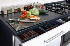Cucina e verdure Immagine Stock
