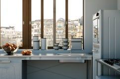 Cucina moderna bianca in una casa con una bella progettazione Immagini Stock