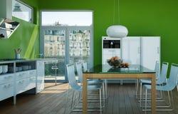 Cucina moderna bianca in una casa con le pareti verdi Immagini Stock
