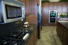 Cucina moderna con la stufa Immagine Stock