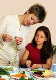Cucinando con la mamma Fotografia Stock Libera da Diritti