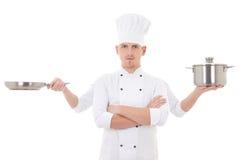Cucinando concetto - il giovane in uniforme del cuoco unico con quattro mani tiene Fotografia Stock