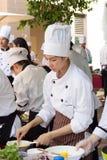 Cucinando la scuola della concorrenza degli studenti della gestione di impresa (cuoco unico minore del ferro) Fotografia Stock