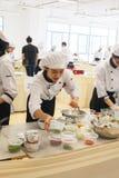 Cucinando la scuola della concorrenza degli studenti della gestione di impresa (cuoco unico minore del ferro) Fotografia Stock Libera da Diritti