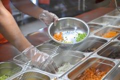 Cucinando nel fast food Fotografia Stock