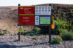 Cuckmere Haven emergency instructions board. Safety instructions for coastguard. Tourism and safety concept. stock photo