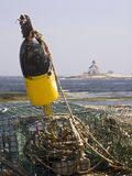 Cuckold's Isalnd Light with Fishing Gear. A lobster trap and float in the foreground with the Cuckold's Island Lighthouse in the background. Maine, USA royalty free stock photo