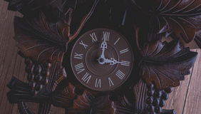 Cuckoo clock hanging on a rustic wooden wall royalty free stock photos