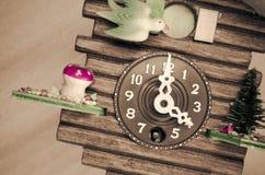cuckoo wall clock, three o'clock Royalty Free Stock Images