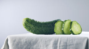 Cucmber and slices Stock Images