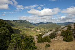 Cucugnan, a small French village in the Pyrenees, seen from a mountain. Cucugnan seen from the path leading to the Cathar castle Quéribus in the Pyrenees Royalty Free Stock Photo