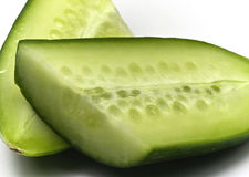 Cucumber. Continental Cucumber – longitudinal cut on white royalty free stock photos