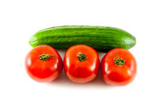 Cucumber. Tomatoes with cucumber on a white background Stock Photos