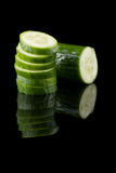 Cucumber. Green cucumber sliced rings on a black background Stock Photos