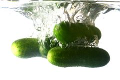 Cucumber. Splash isolated on white background royalty free stock images