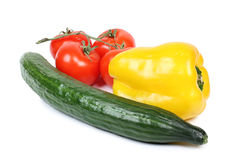 Cucumber And Peppers On White Stock Photo