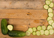 Cucumber background on a rustic table Royalty Free Stock Photography
