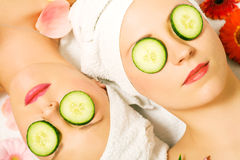 Cucumber beauty girls in spa Stock Photos