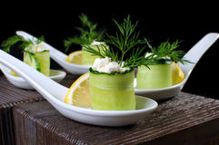 Cucumber canape with ricotta. And lemon slice close-up. Horizontal shot. Foreground Stock Image