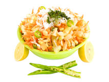 Cucumber and carrot salad. Cucumber salad with a garnishing of soaked lentils, onion chops, carrot gratings, coconut gratings and coriander Royalty Free Stock Photo