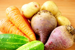 Cucumber, carrots, beets, potatoes on the table Royalty Free Stock Image