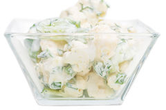 Cucumber and cauliflower salad with sour cream. Stock Image