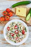 Cucumber, cheese, omelette, ham, tomato salad Royalty Free Stock Photos