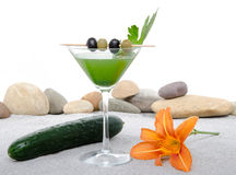 Cucumber cocktail in a environment of sand and pebble stones Royalty Free Stock Image