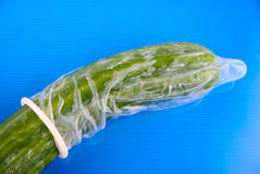 Cucumber in a condom Royalty Free Stock Images