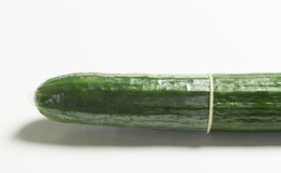 Cucumber in a condom Royalty Free Stock Photo