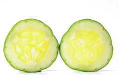 Cucumber, cut two pieces on a white background. Royalty Free Stock Photography