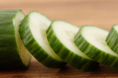 Cucumber on Cutting Board Royalty Free Stock Photos