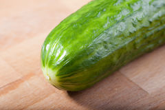 Cucumber on a cutting board. A cucumber on a cutting board Royalty Free Stock Photo